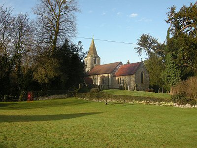 St Radegund Church stretching up from the village green.